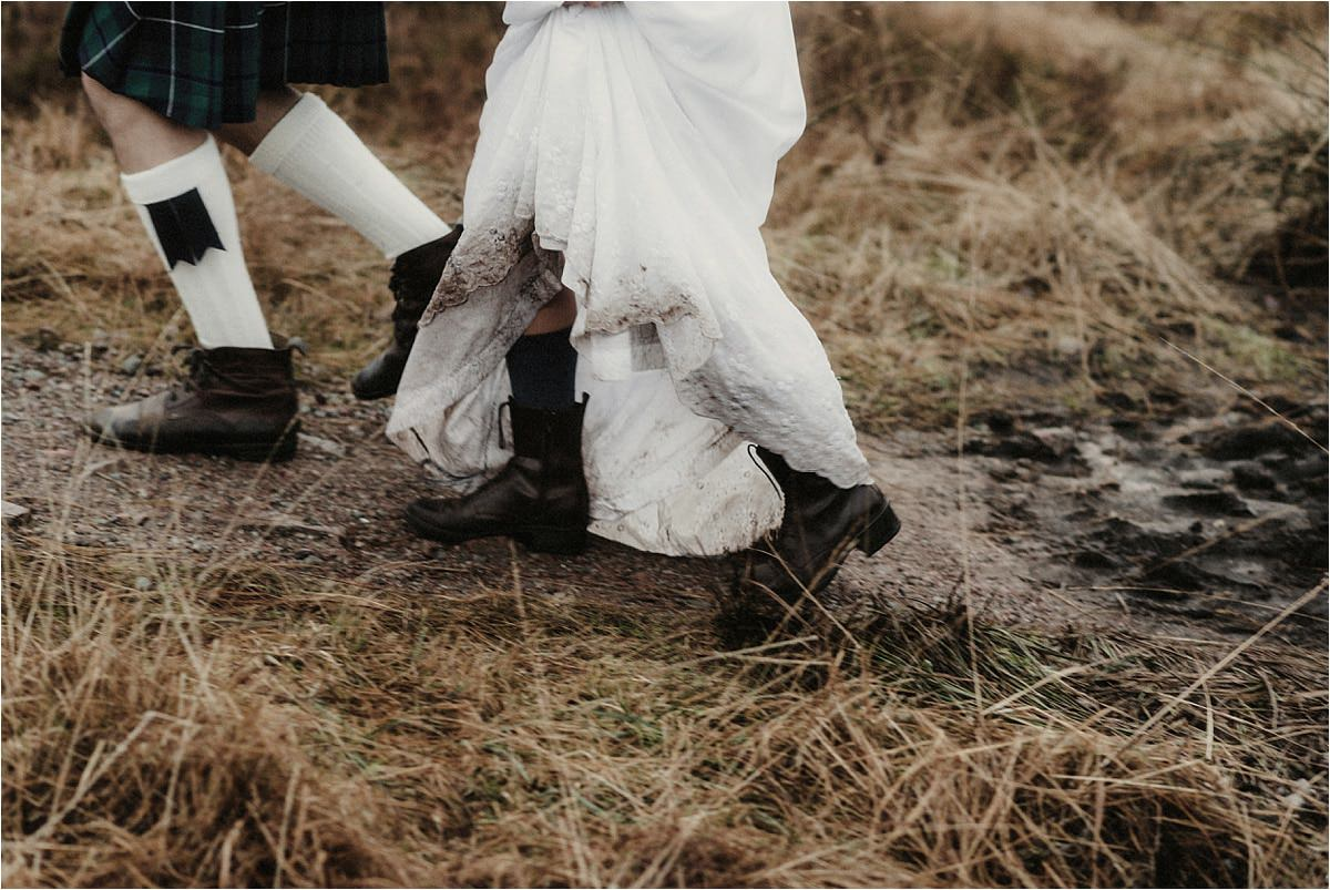 a couple and their footwear during an elope to scotland in glencoe
