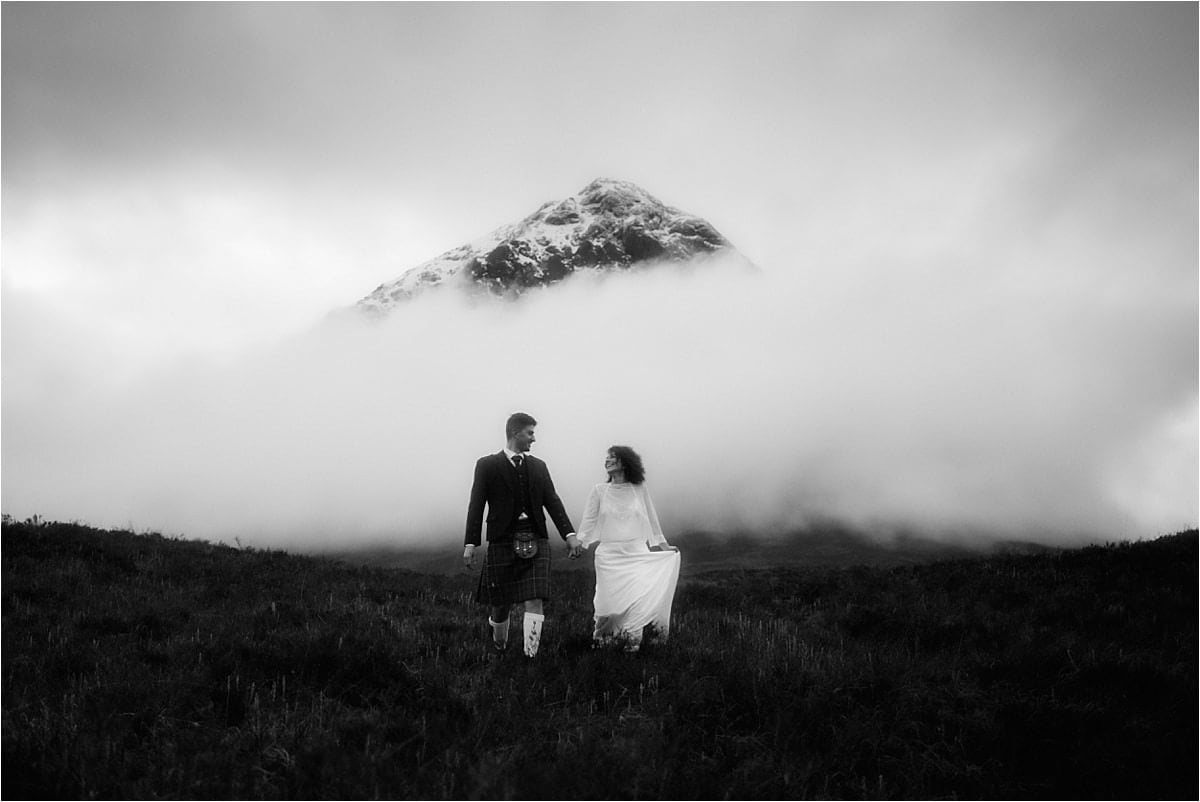 elopement in scotland couple walking in Glencoe