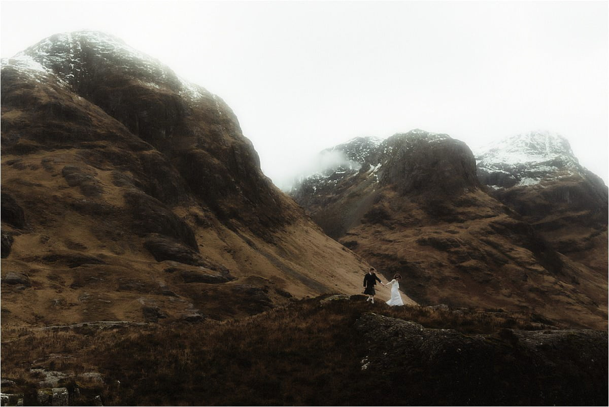 bride and groom walking in Glencoe during Scottish elopement