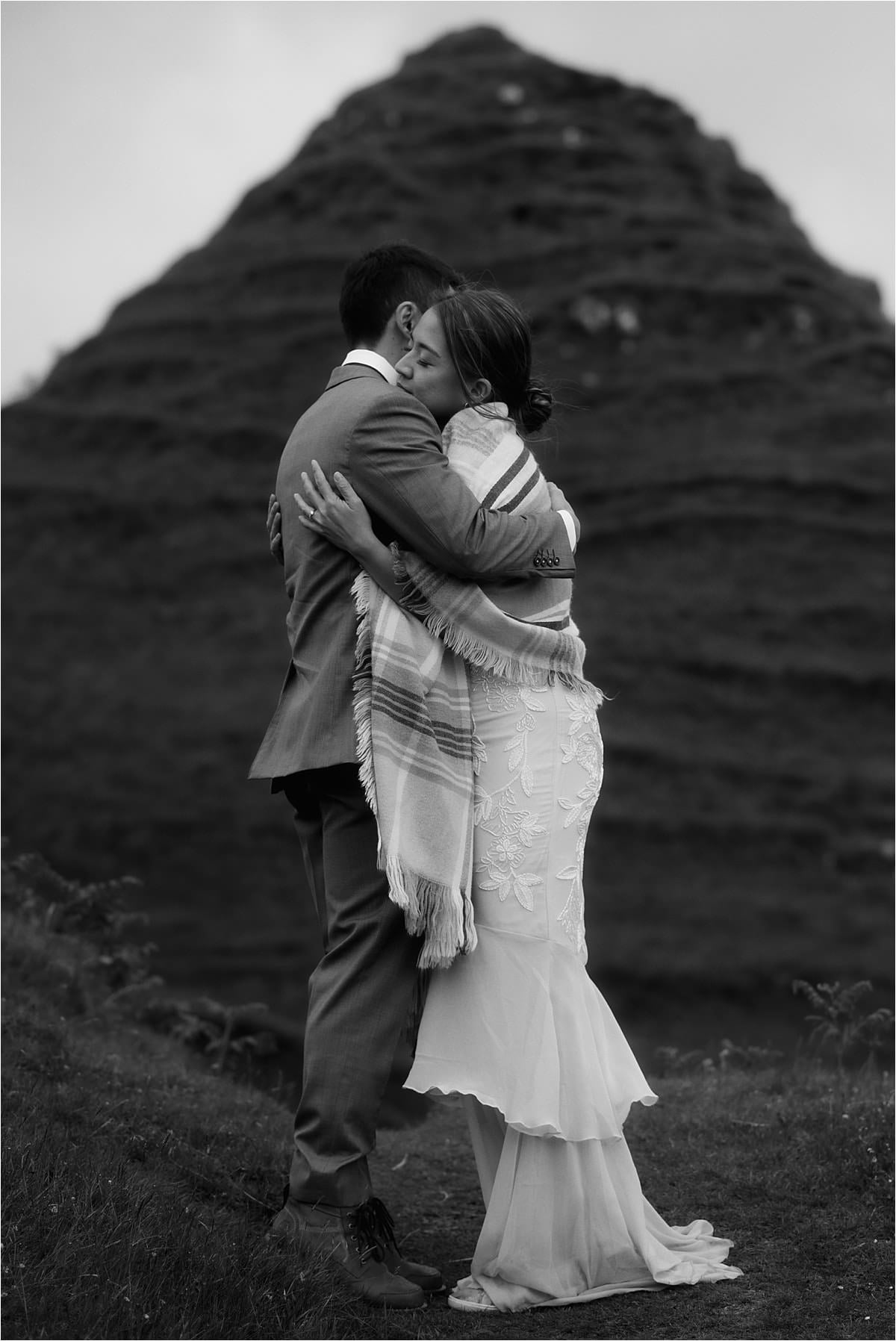 A couple hug at the fairy glen during their isle of skye elopement