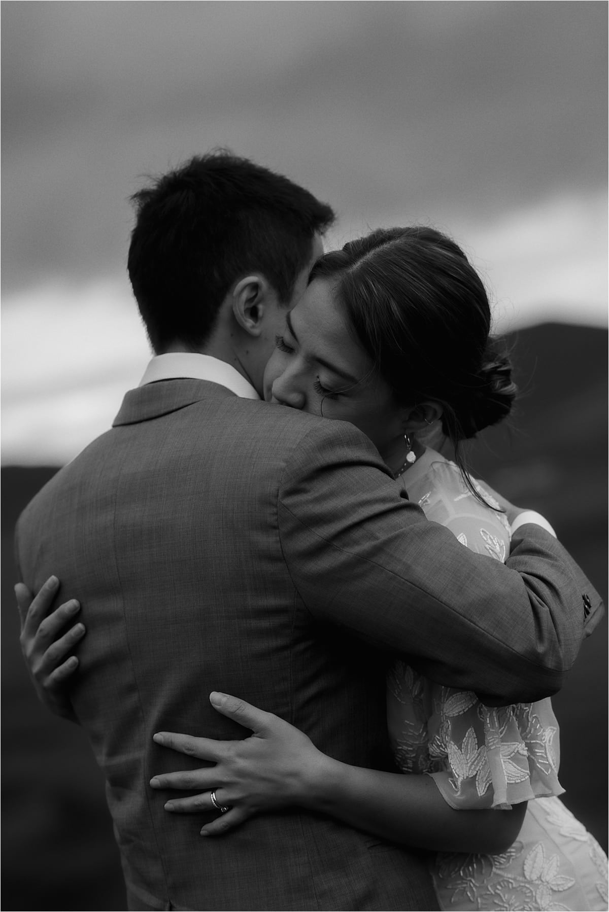 couple hugging during their isle of skye elopement
