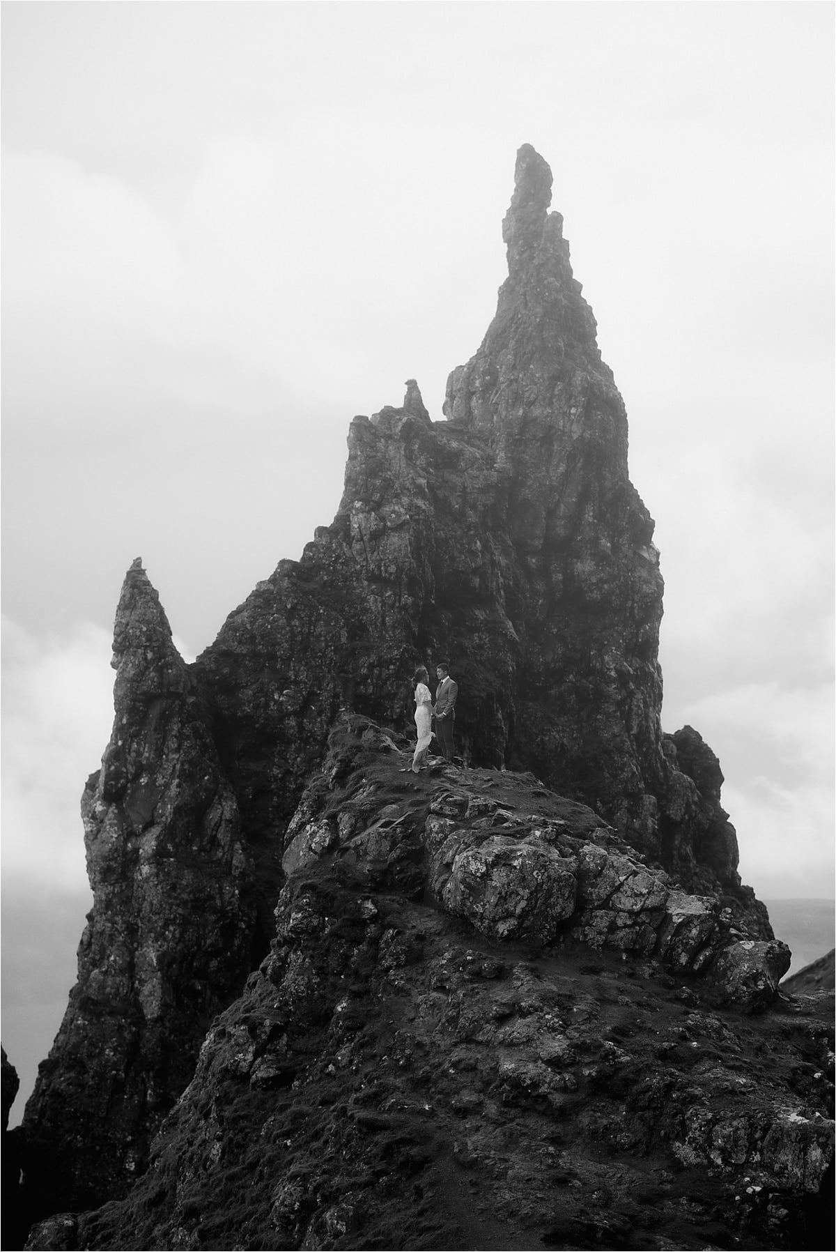 isle of skye elopement couple standing on the old man of storr