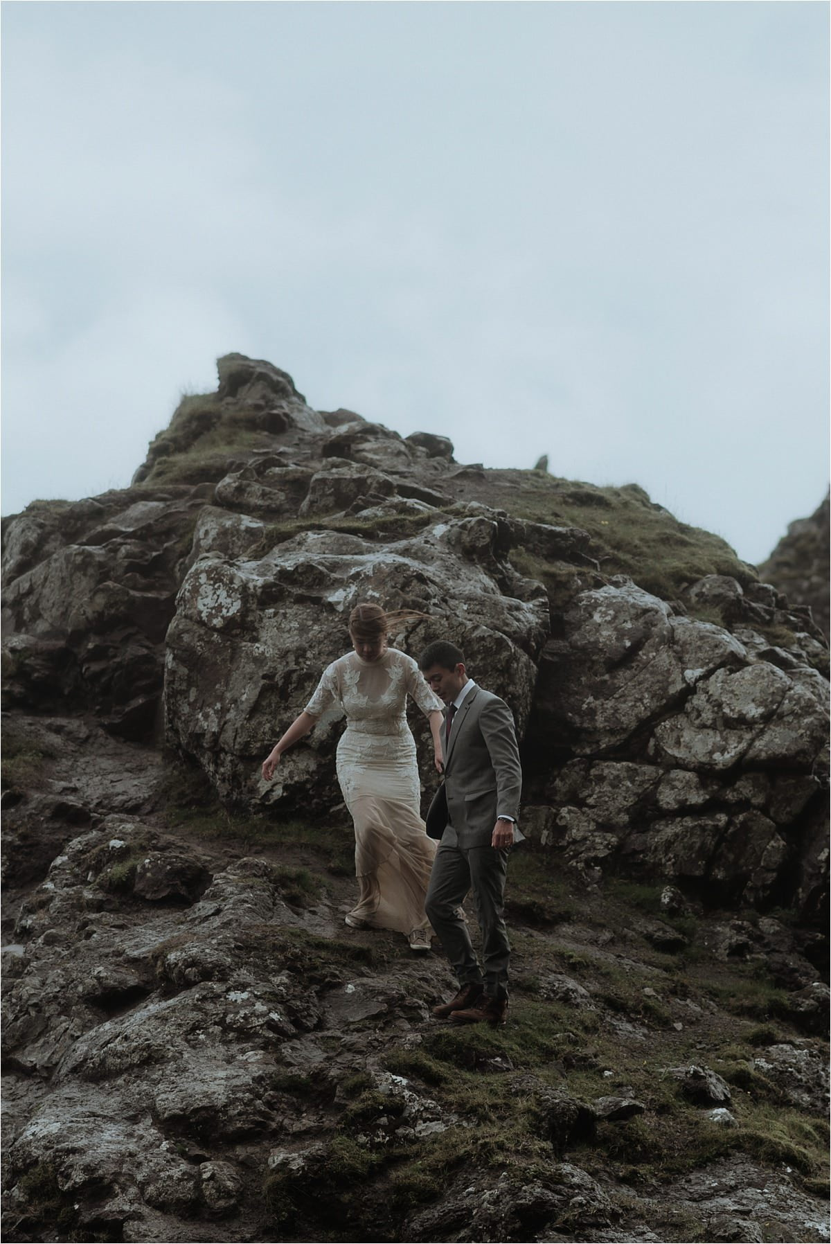 couple walking on the isle of skye during old man of storr elopement