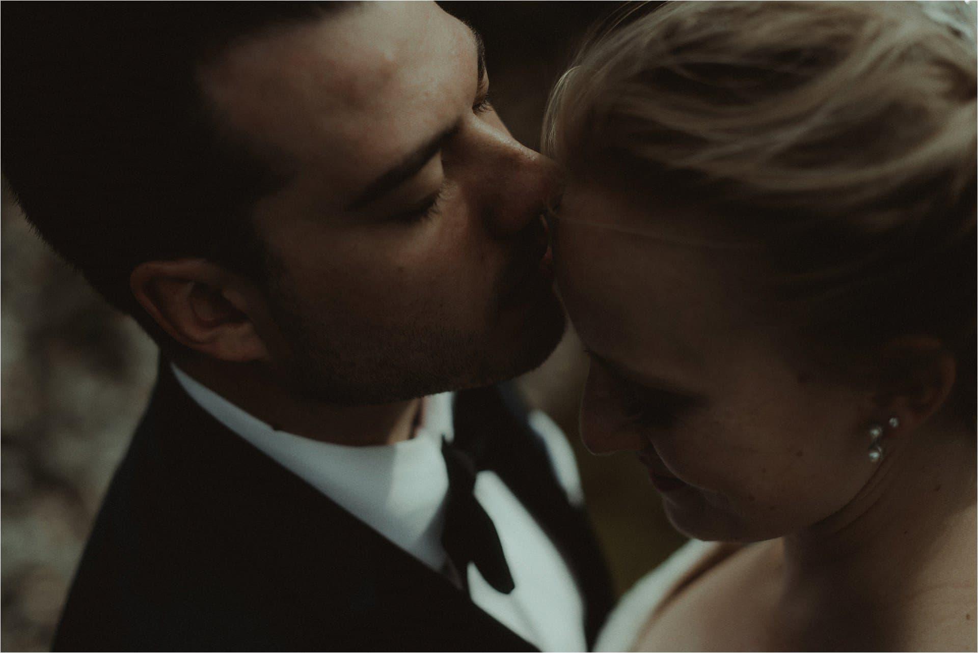 skye elopement couple kissing in the fairy glen