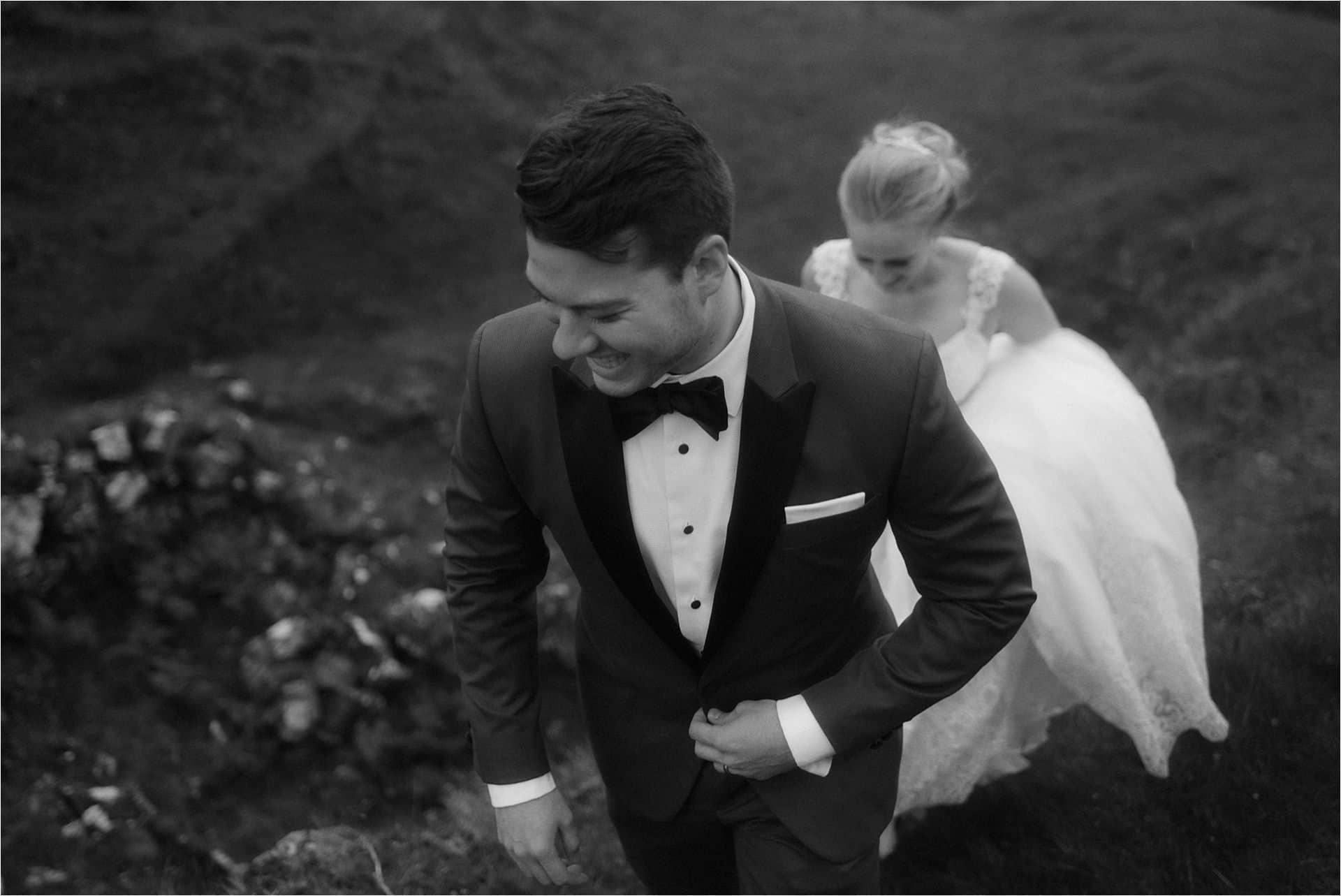 elopement on skye couple walking in fairy glen