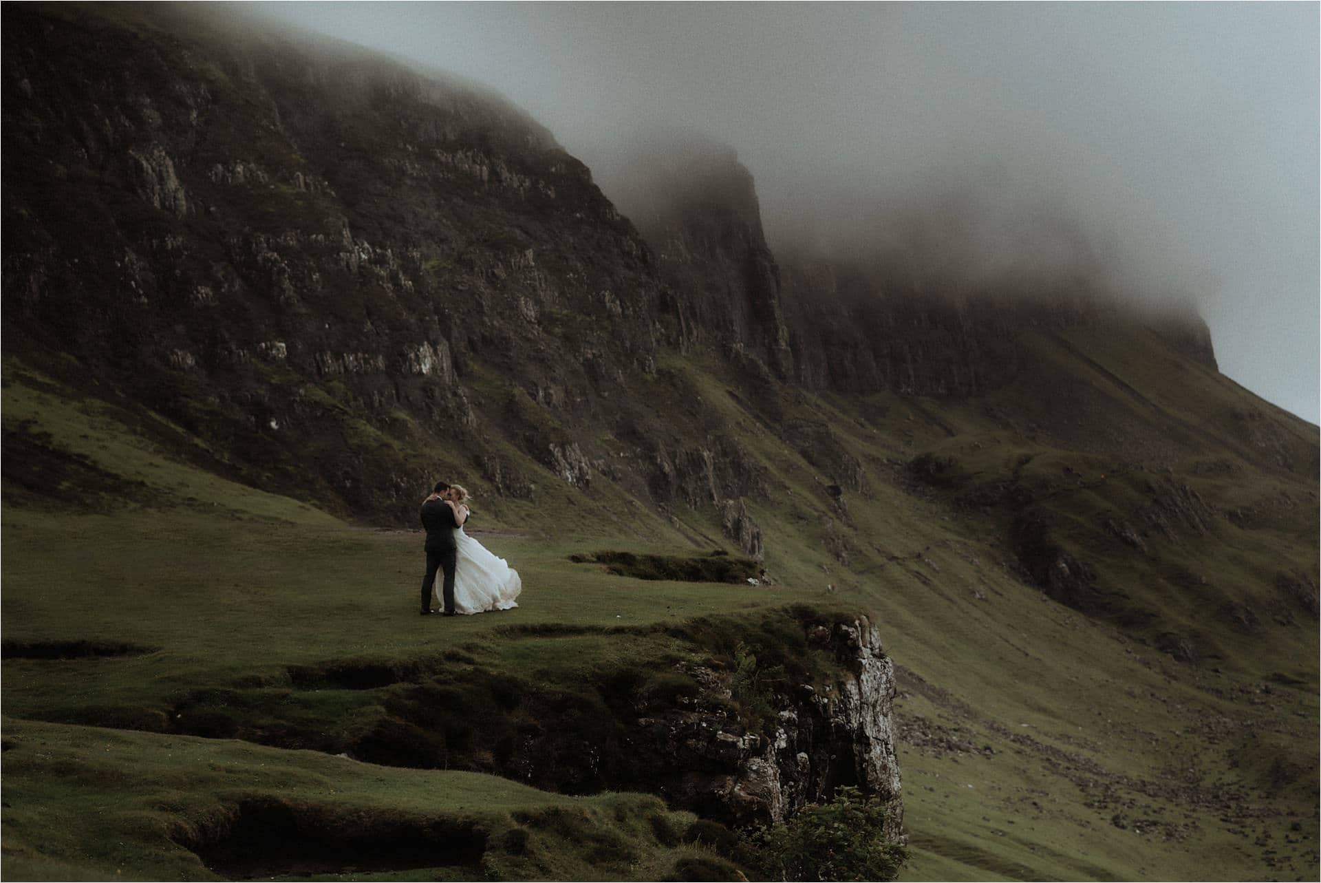 bride and groom in the misty mountains on isle of skye