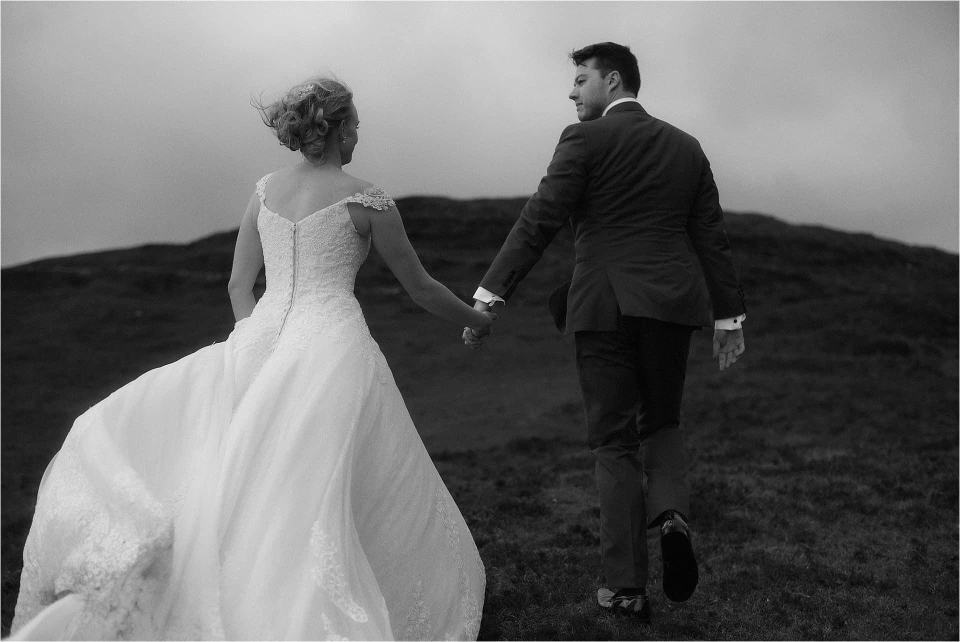 isle of skye elopement couple walking in the landscape