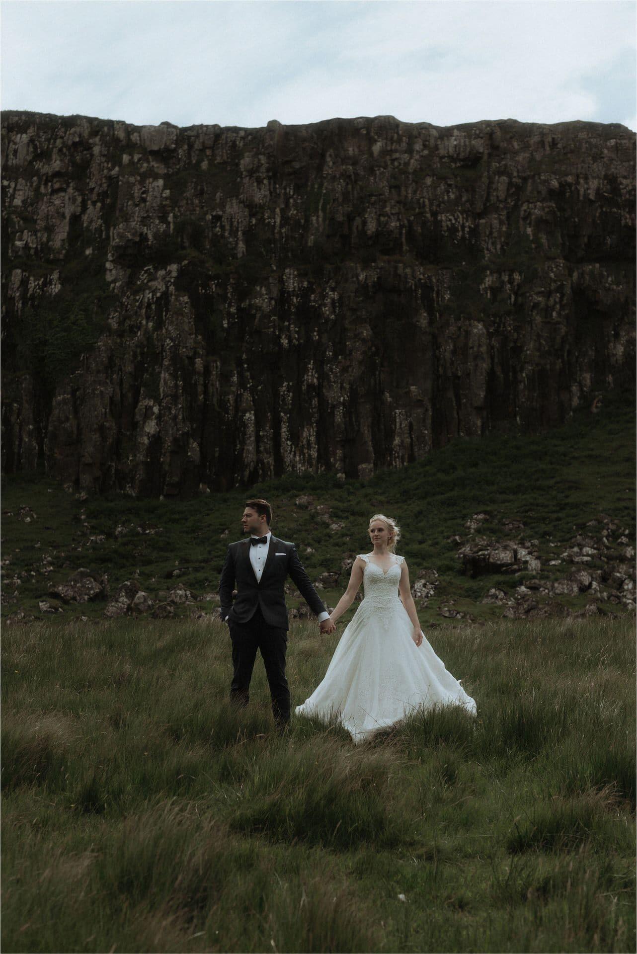 elope in scotland couple walking in fairy glen on isle of skye