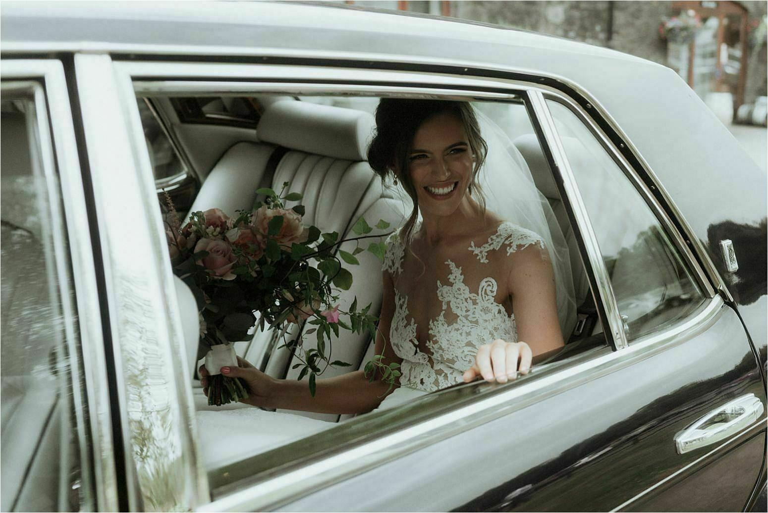 scottish wedding at bachilton barn bride arrives in car