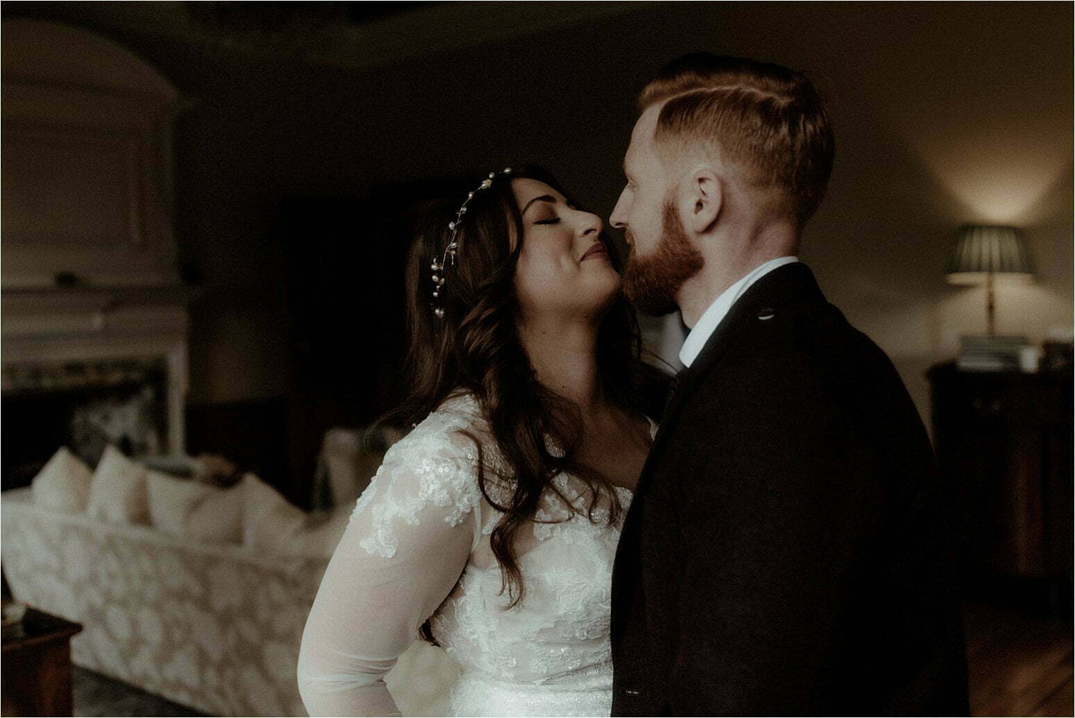 bride and groom kiss after wedding in scotland