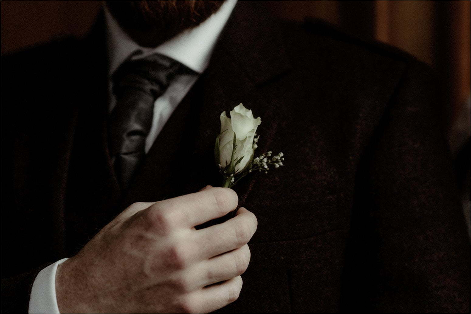 groom flower detail during elopement in scotland