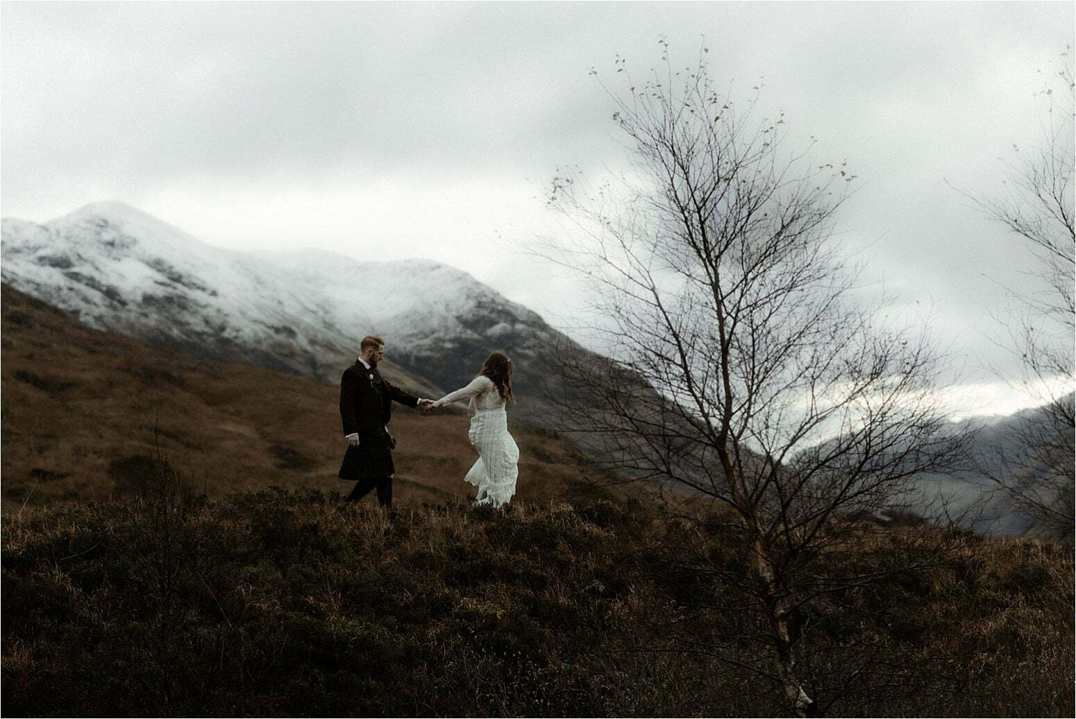 elopement in scotland couple walking in glencoe mountains