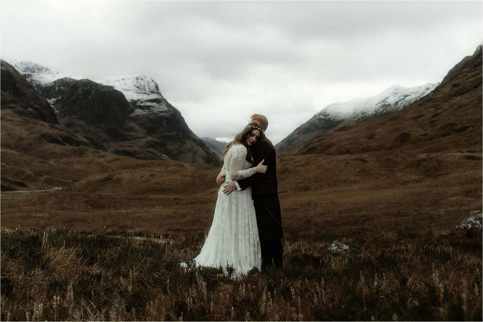 elope in scotland couple hugging in the mountains of glencoe