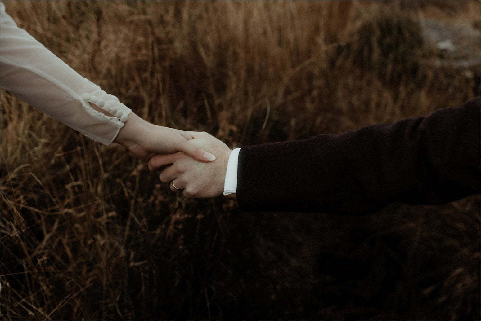 hands of bride and groom in scotland