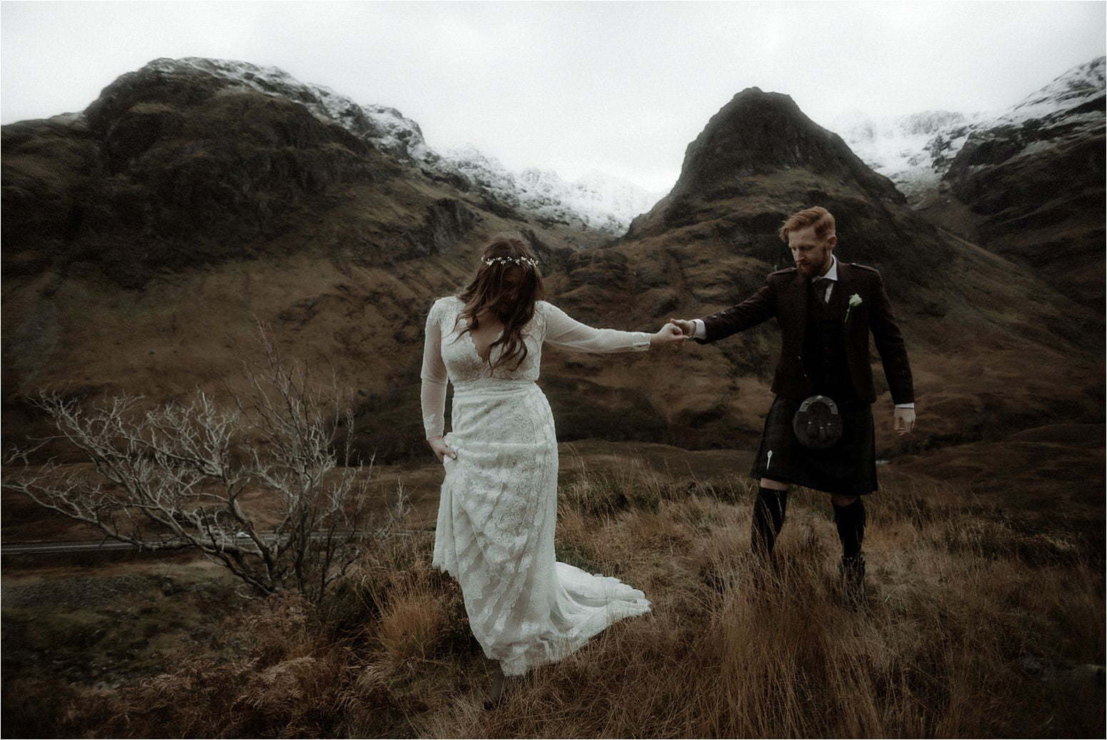 elope in scotland couple walking in the mountains of glencoe