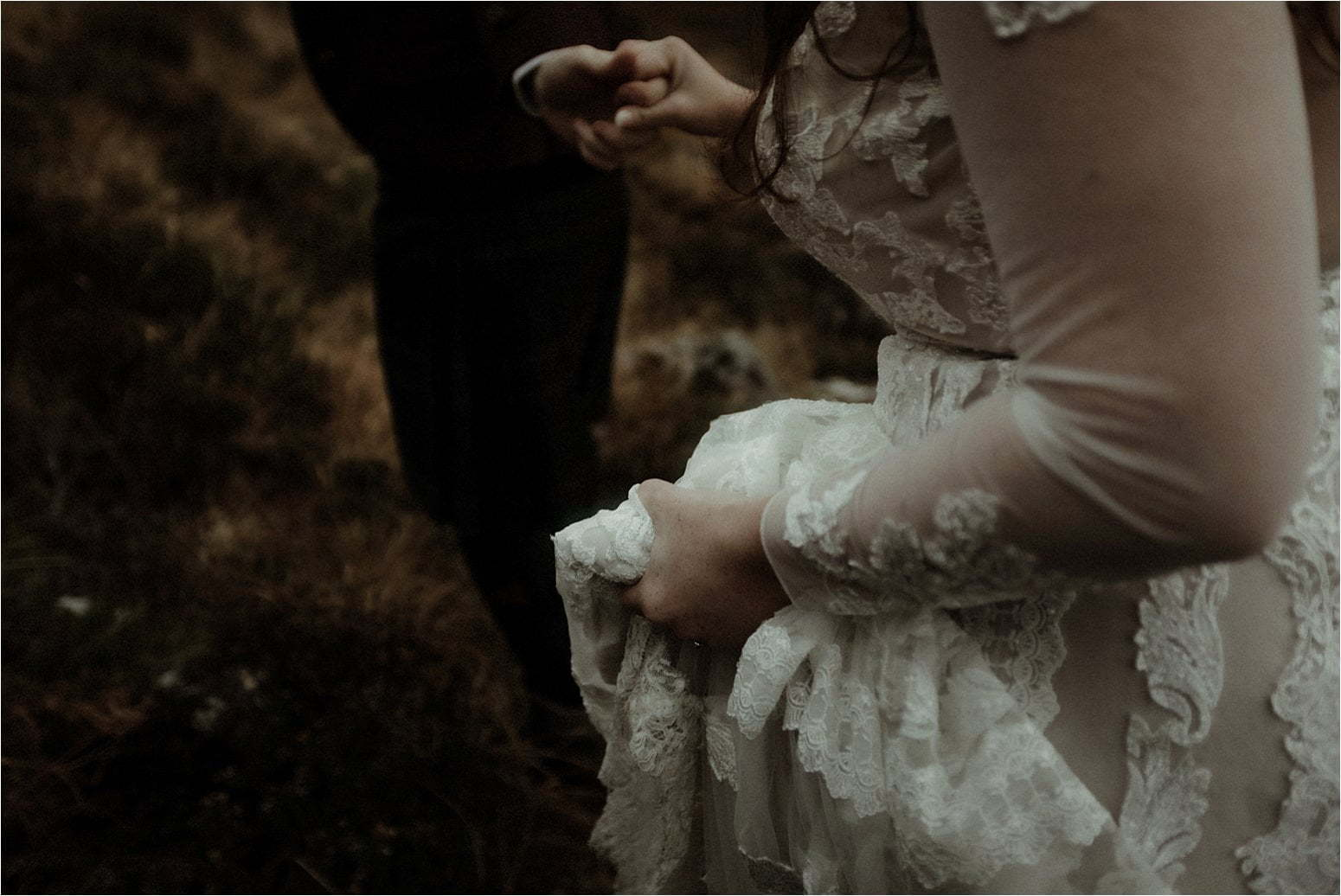 bride and groom walking in the mountains during their elopement in scotland