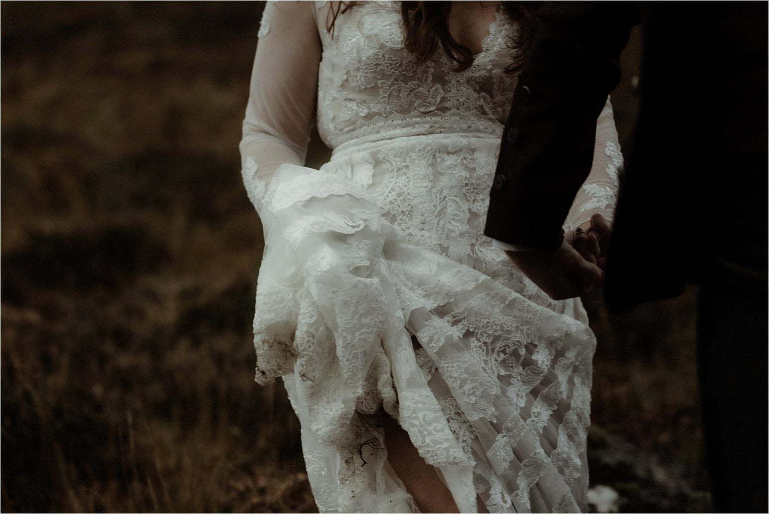 detail of brides dress in scottish elopement