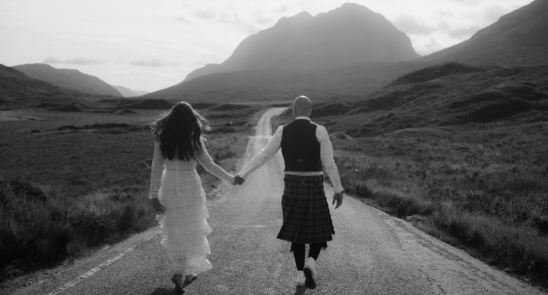 elope in scotland couple walking in torridon