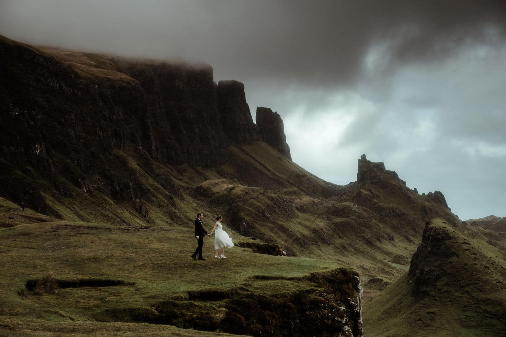 bride and groom walking at the quirking on the isle of Skye after their elopement