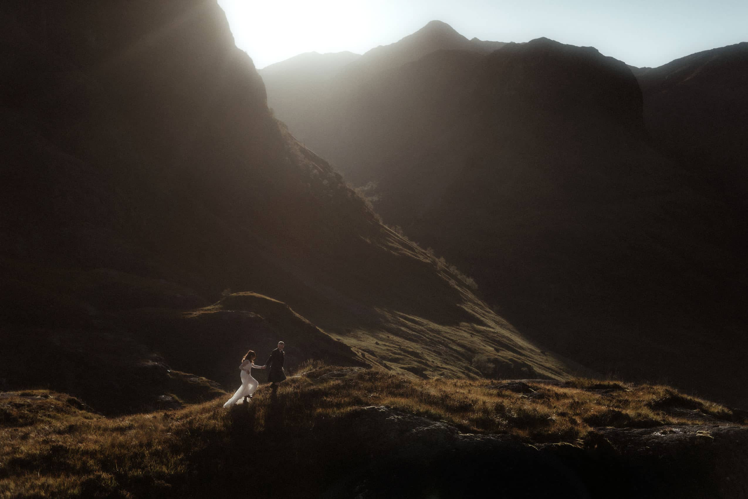 elopement in scotland couple walking in the mountains of Glencoe after their autumn elopement