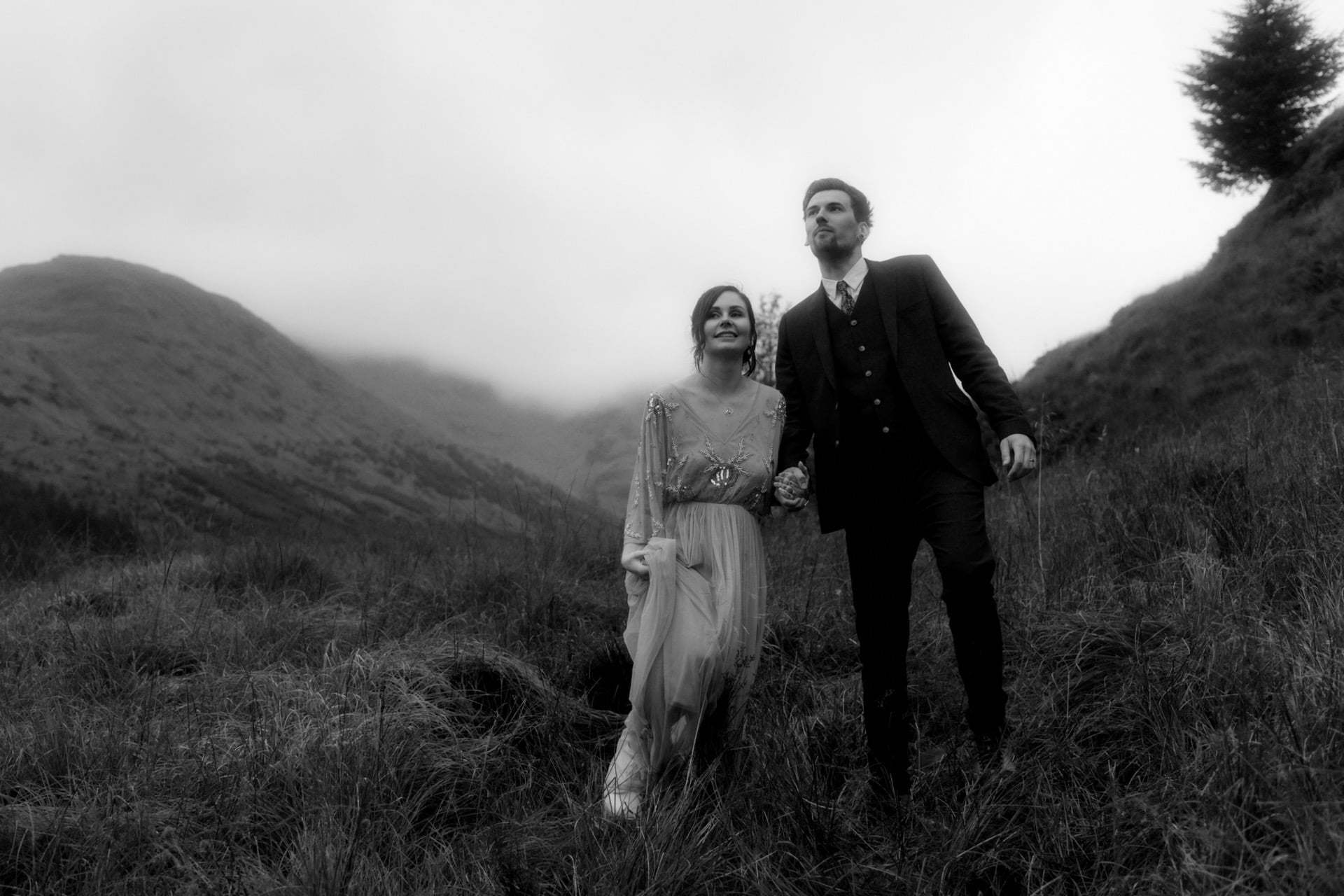 elope in scotland couple walking in the mountains
