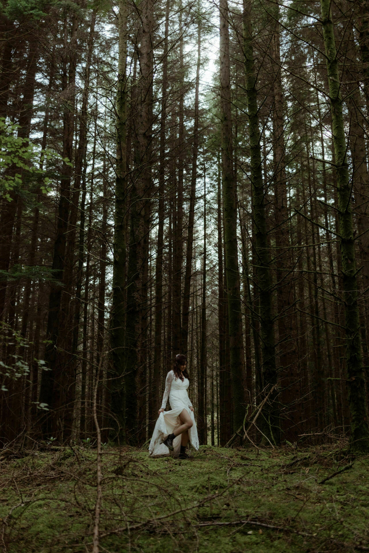 bride in woodland during Scottish elopement