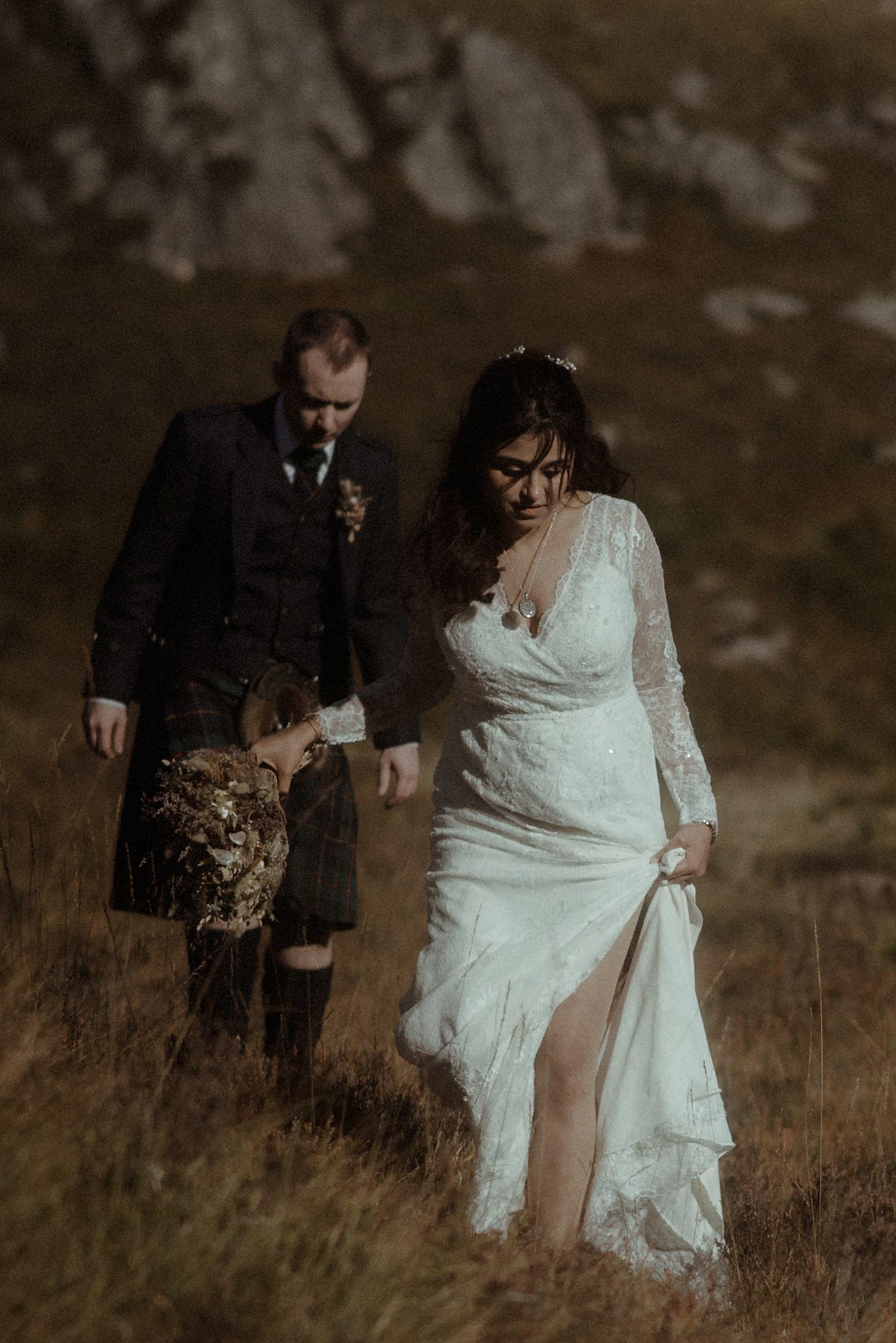 elope to Scotland couple walking in glencoe