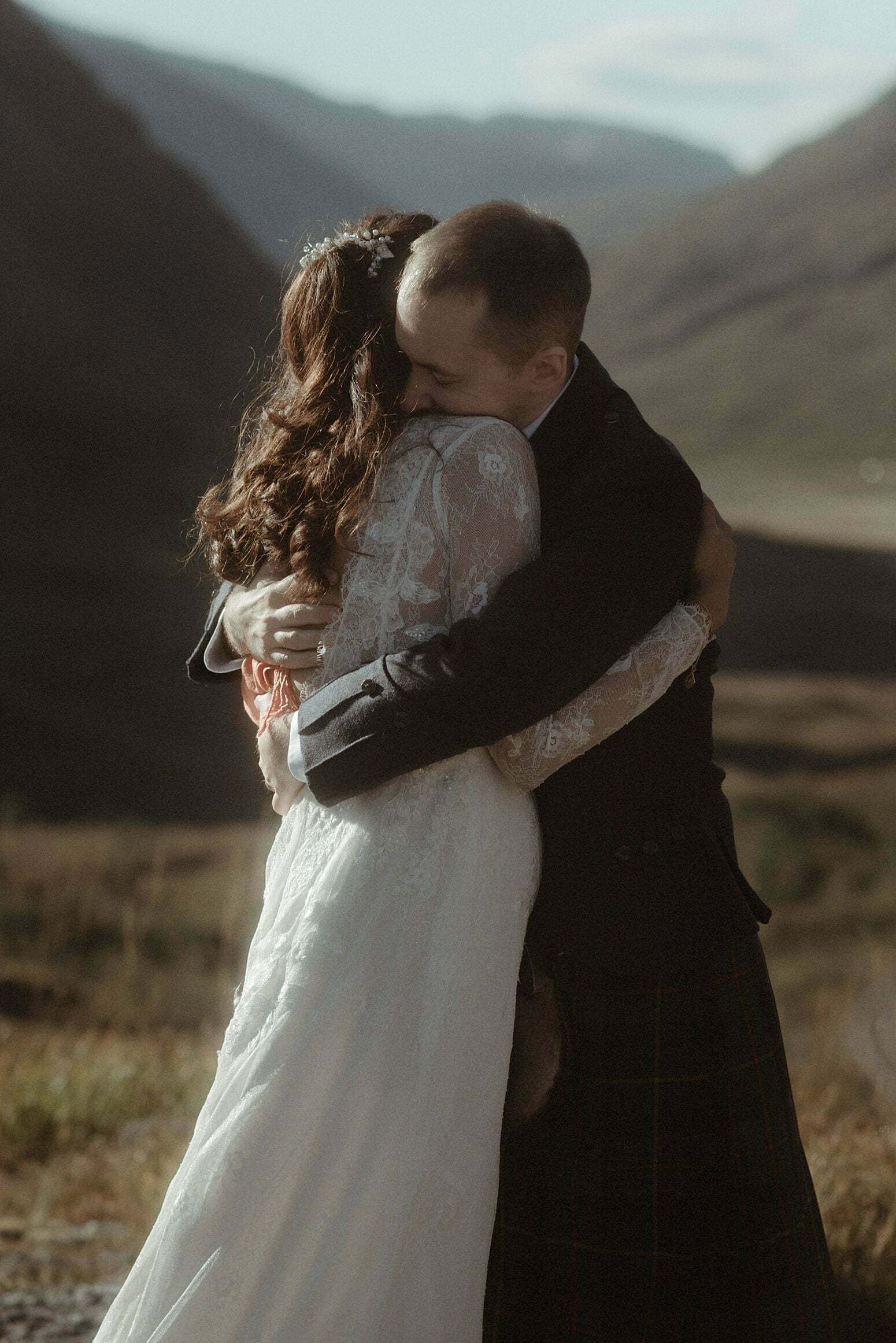 a couple hugging after their Autumn elopement in Scotland in the mountains of Glencoe