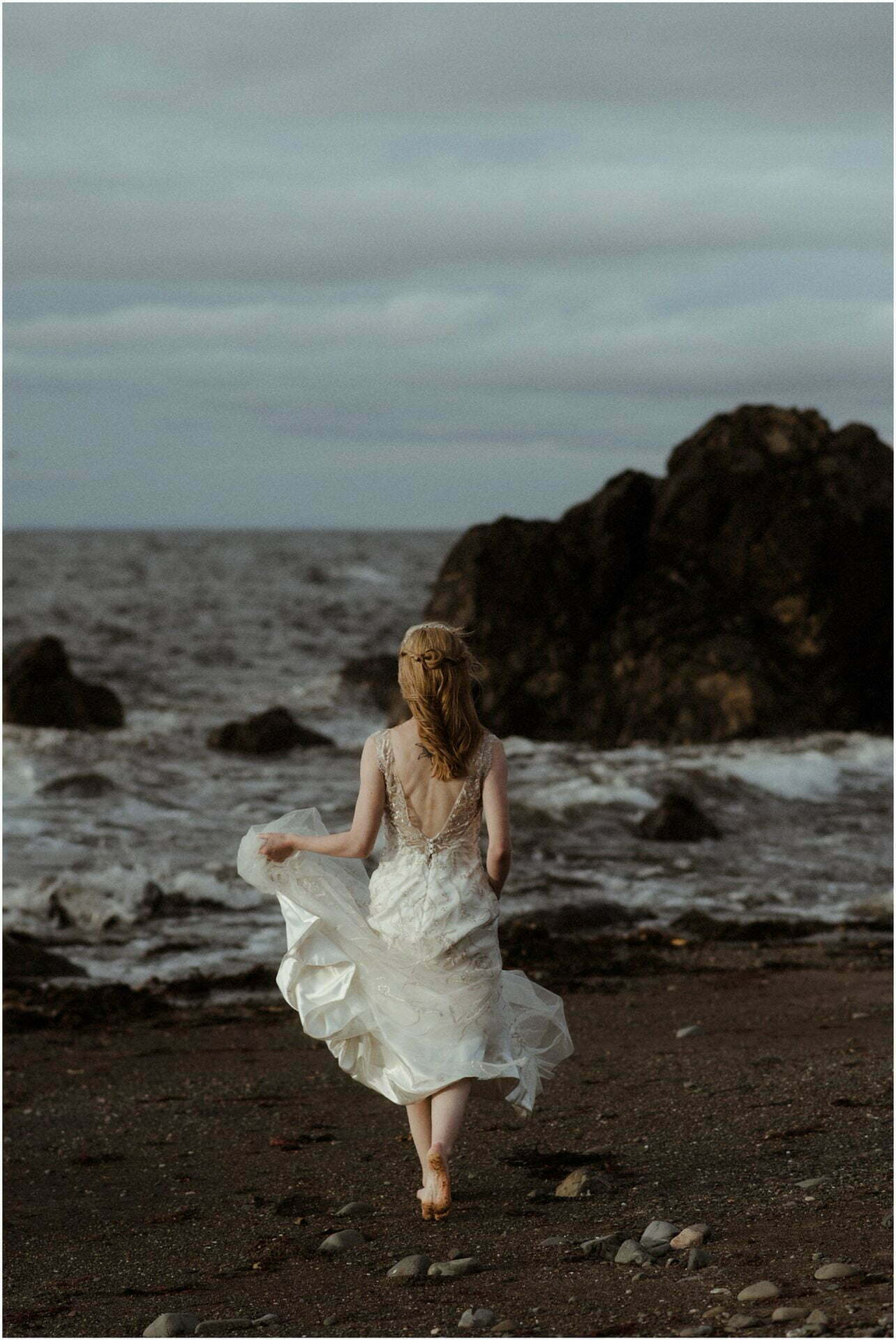 bride running on a beach in scotland