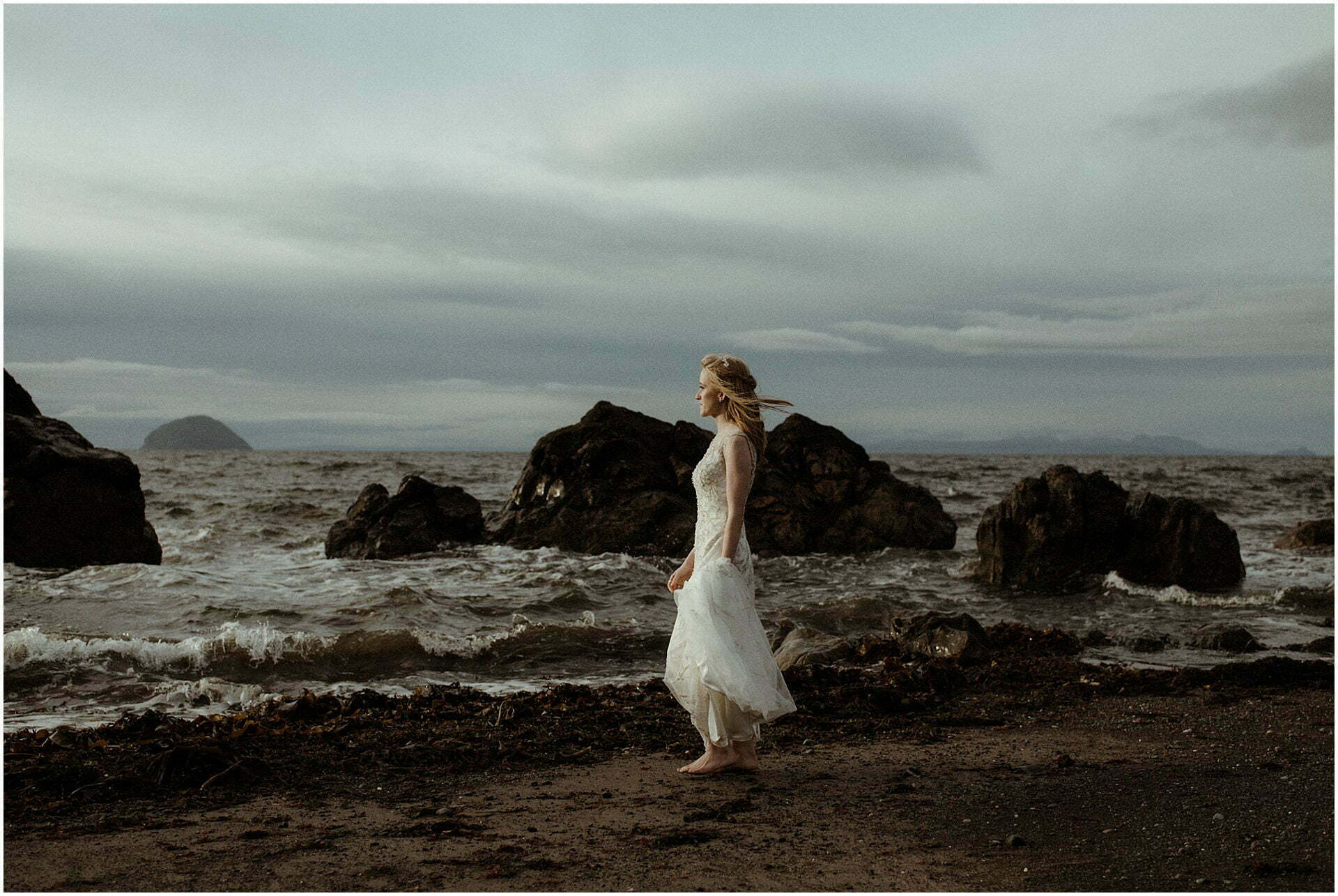 scotland elopement bride walking on a beach