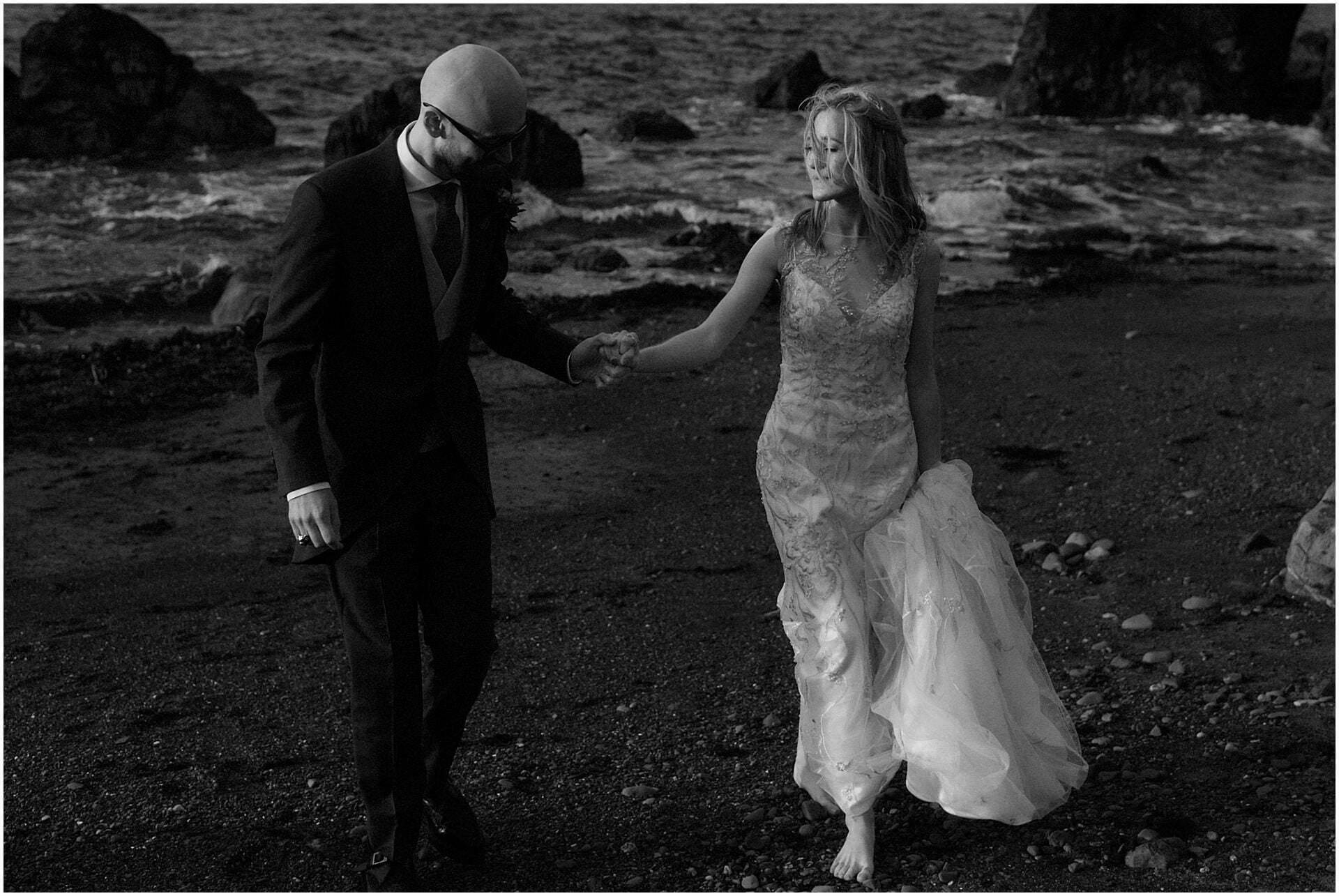 scotland elopement bride  and groom walking on a beach