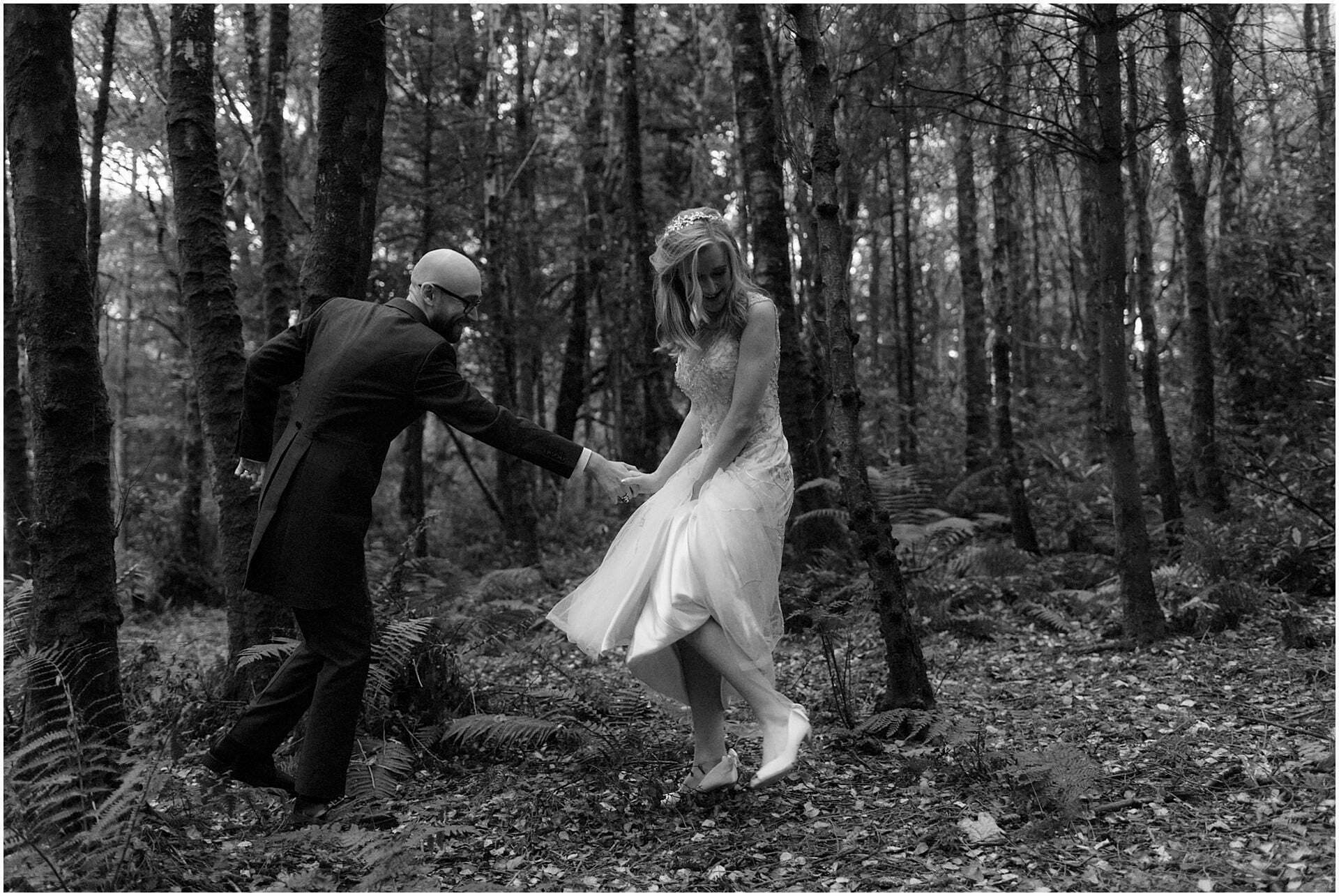 eloping in scotland bride walking in woodland