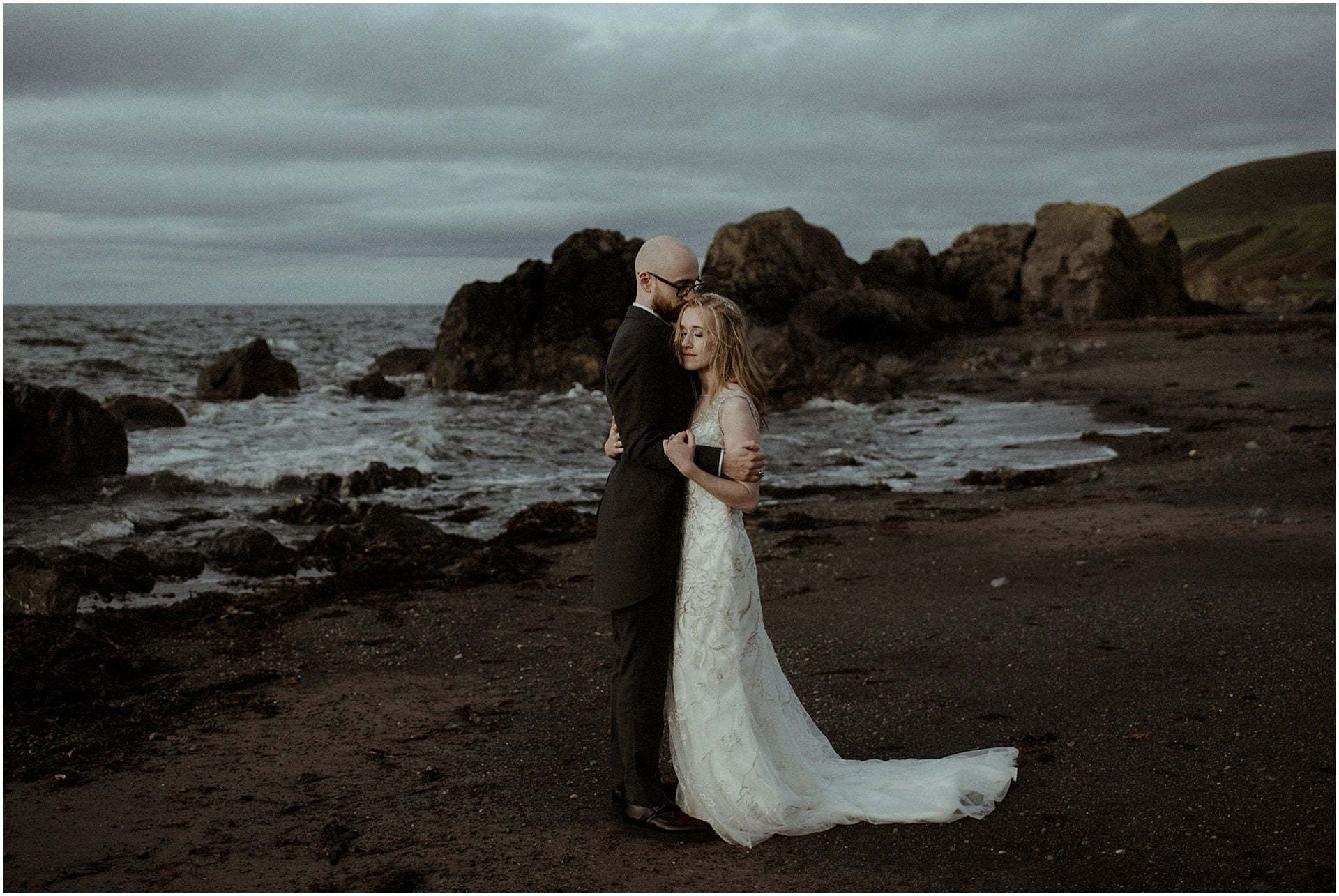 portrait of elope in Scotland bride and groom walking on the beach in Ayrshire