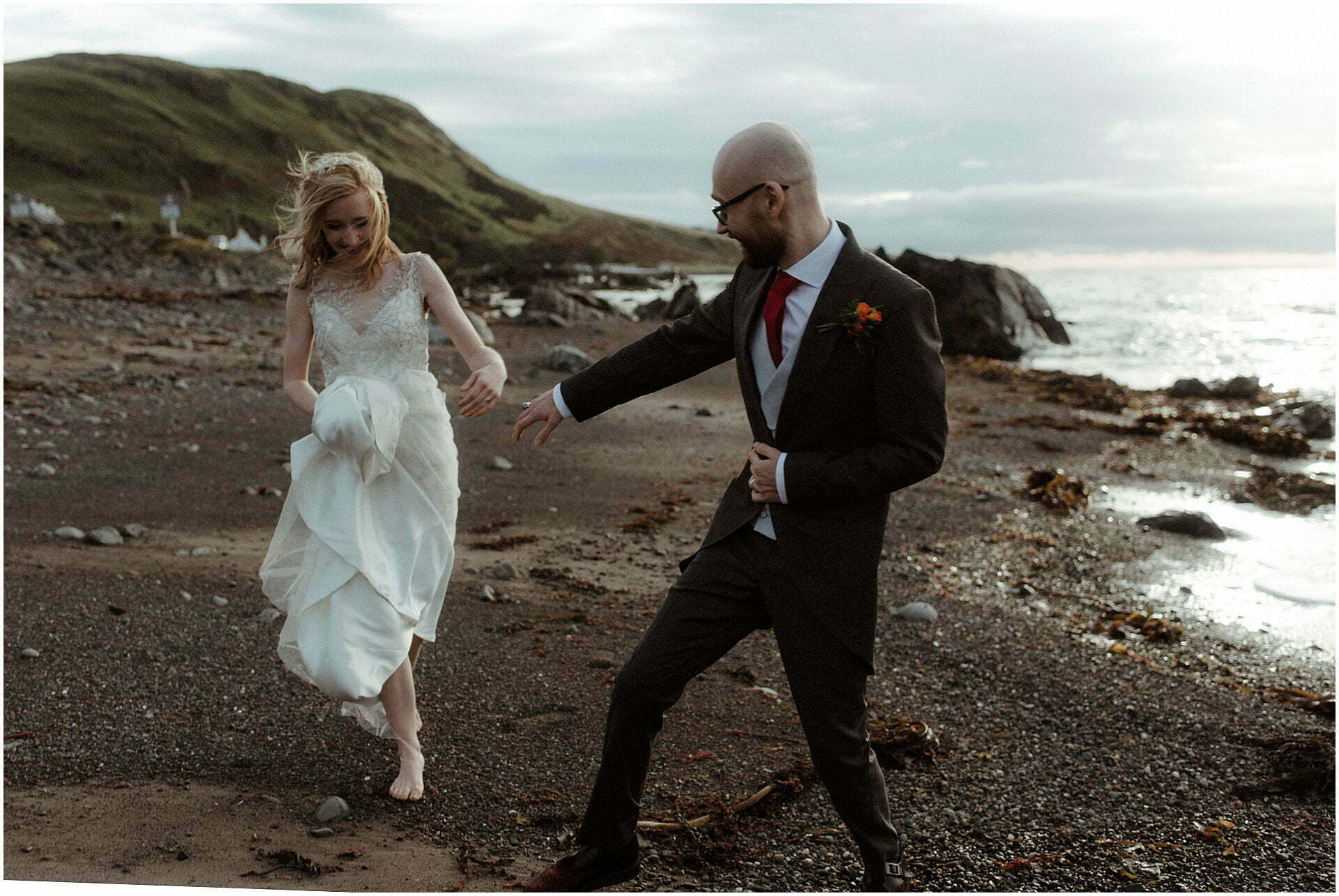Scotland elopement on the West coast couple walking on beach