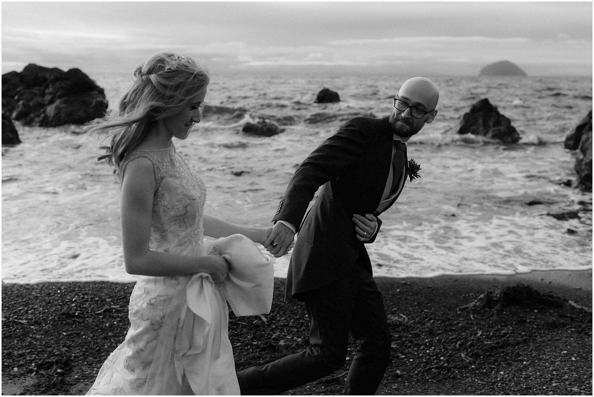 Scottish elopement on the West coast couple walking on beach