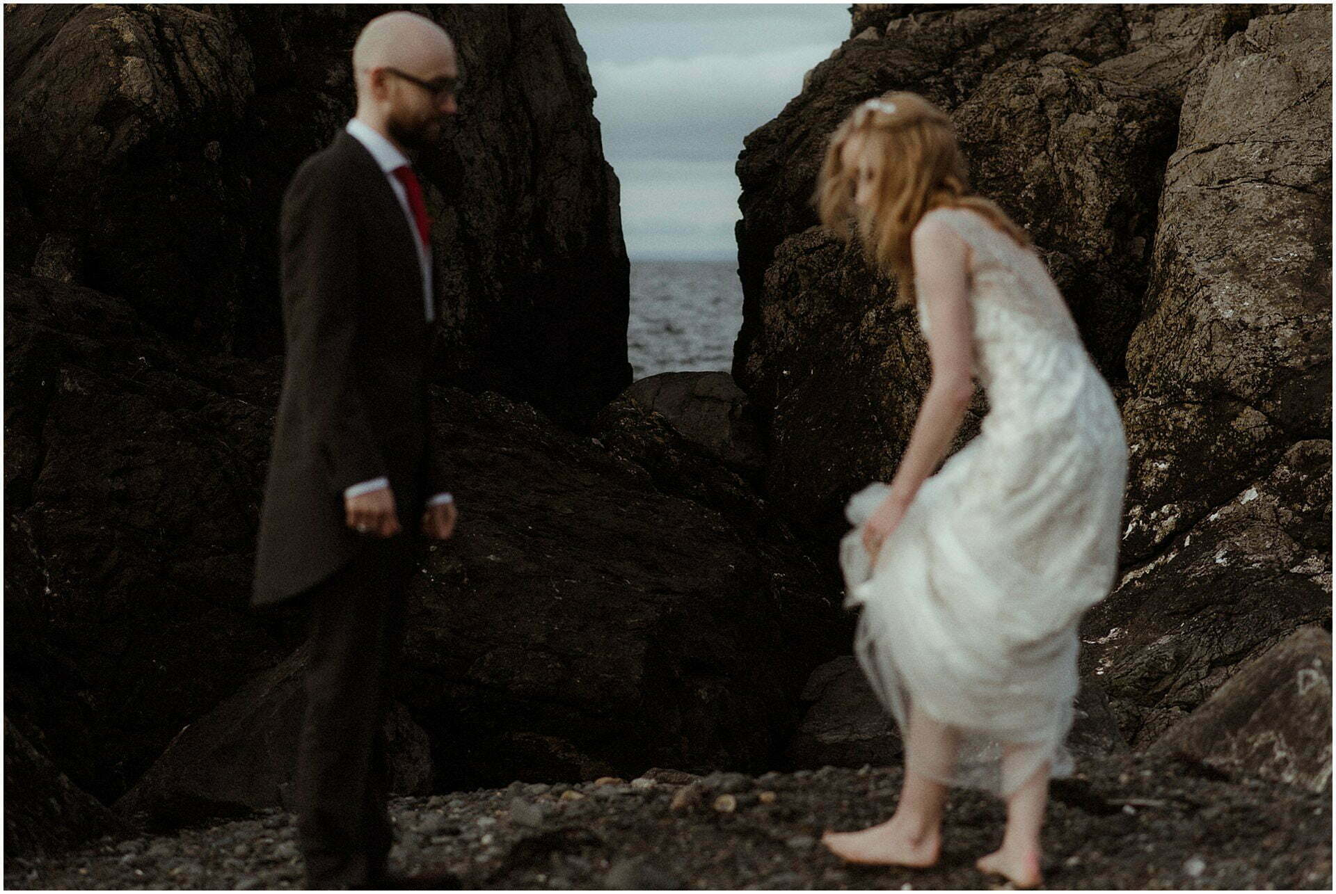 Scottish elopement on the West coast couple walking on beach